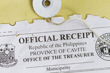 manila envelop: macro shot of official receipt with manila envelop