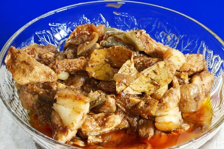 embutido: Menudo spanish dish with a bright blue background