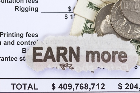 earn more: Earn more abstract - dollar with spread sheet documents.