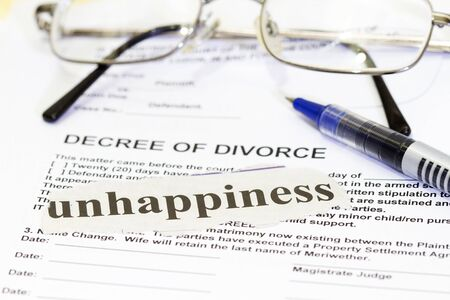 unhappiness:  Divorce Paperwith unhappiness cutout and pen. Stock Photo