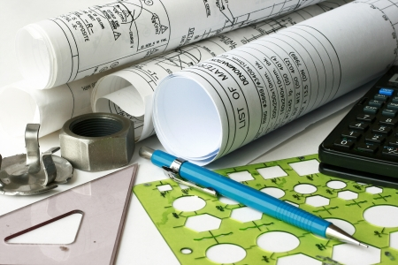 engineering plans: Engineering drawing with blueprint roll - many uses in the oil and gas industry. Stock Photo