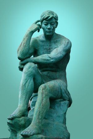 rodin: The thinker statue isolated in white - located in myeoungdong south korea. Stock Photo