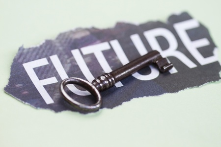 accomplishments: Concept of future with old antique key.