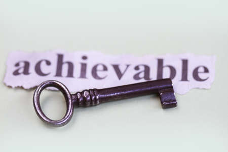 achievable: Achievable with old key abstract in a light color background