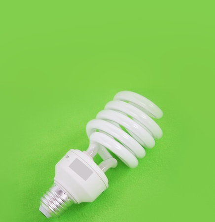 spiral bulb laid on a green background photo