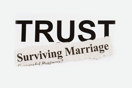 Surviving marriage abstarct with word TRUST in the background. photo