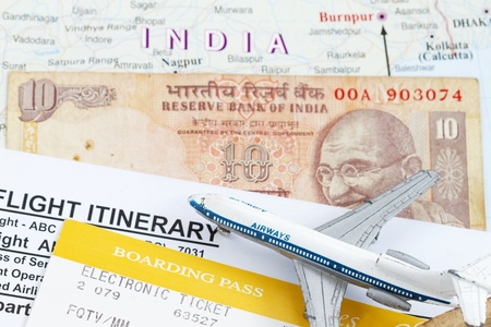 itinerary: Trip to India abstract with toy airplane and boarding pass. Stock Photo