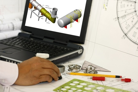 An engineer drafting engineering works with blank monitor Stock Photo