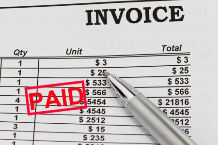 Paid Invoices abstract with pen and dollar billing schedule