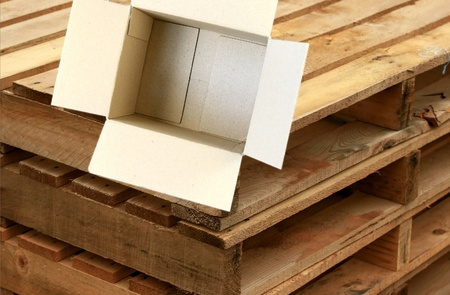 carboard box: Open Carboard Box - concept for gifts and other ideas with wood crate in tje background