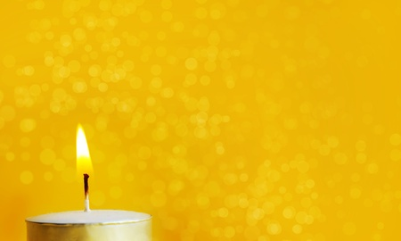 christian candle: One Burning candle in a yellow background