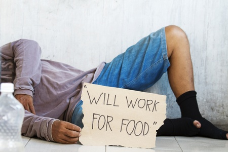 Homeless, unemployed and  hungry begging for food