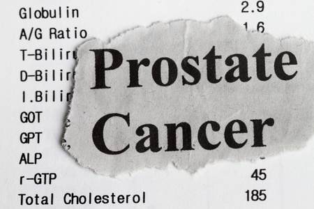 testicular cancer: Prostate cancer abstract with medical result and newspaper cutout