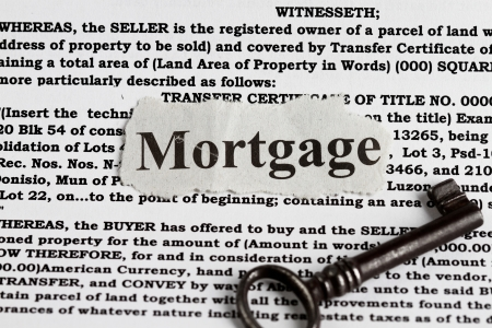 mortgage rates: house mortgage with definition and vintage key abstract Stock Photo
