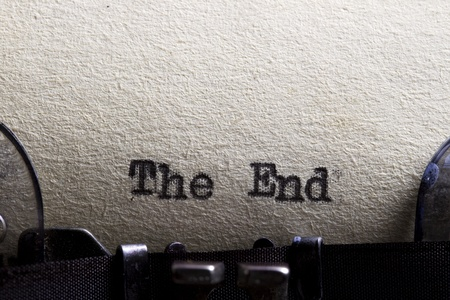 The end    written on an old typewriter and old paper  Stock Photo - 13798394