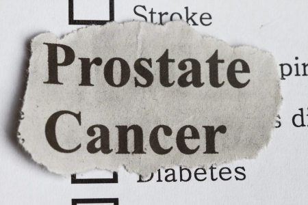 testicular cancer: Prostate cancer abstract with survey and newspaper cutout.