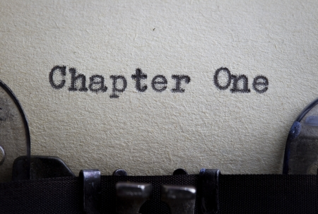 Chapter one typewitten on a vintage paper starting a story or novel concept.