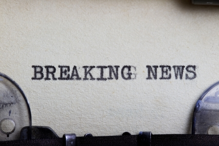 Breaking news type written on a vintage paper. photo