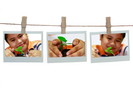 Polaroid templates hanged on a rope over white background  photo
