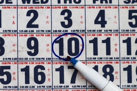31: Close up of gregorian calendar with pen