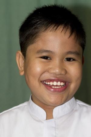 A cute school boy with school uniform  photo