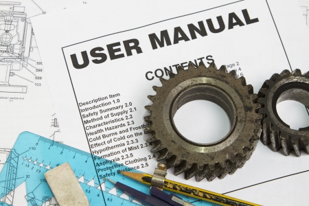 User manual with gears and drawing instruments  Stock Photo