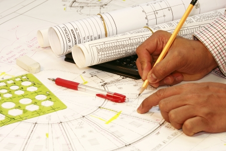 Hand with a pencil on plan at home Stock Photo - 14221855