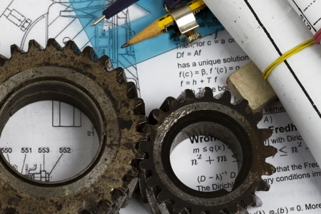 gears or part of engine on plans background photo
