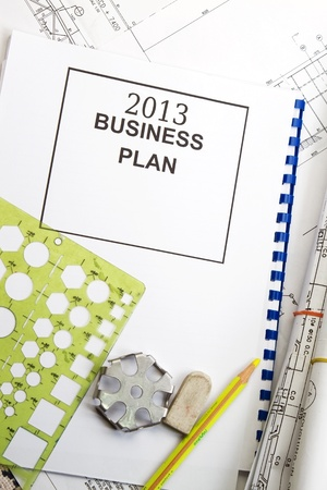 2013 business plan with engineering tools as background  photo