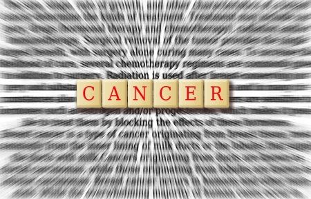 Cancer focus on the word cancer with background radial blur. Stock Photo