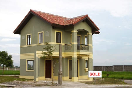 single dwelling: Large upscale residential home with sold placard.