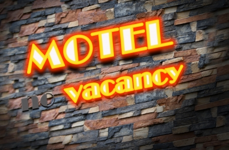 Motel no vacancy with neon lights in a brick wall photo