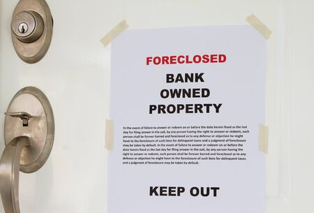 repossessing: Foreclosed notice on a main door of a house  Stock Photo