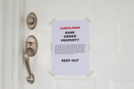 Foreclosed notice on a main door of a house Stock Photo - 16542292