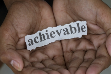 achievable: Achievable cutout hold in two hands macro shot
