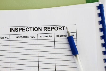 inspectionl report form with folder and pen concept