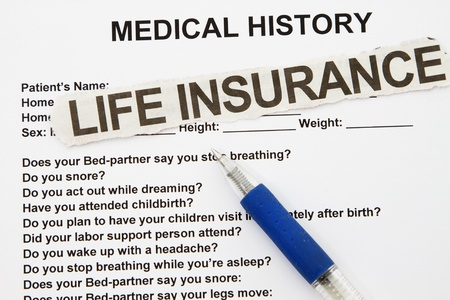 questionaire: Life insurance newspaper cut out with pen and form