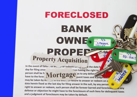 foreclosed: Foreclosure Notice and  House Keys with Selective Focus.