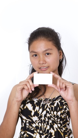 notecard: Portrait of a beautiful young woman holding a blank notecard