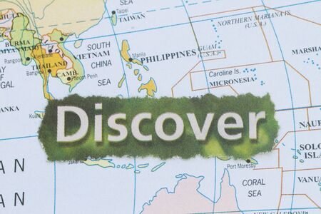Manila on a map with newspaper cutout with focus on discover. Stock Photo - 17502706