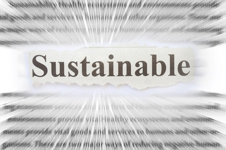 Sustainable newspaper cut out with related words background  photo