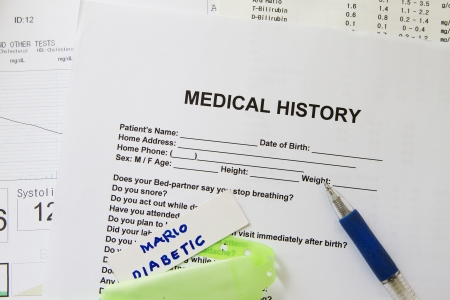 A medical history form with a green nametag Stock Photo - 17903276