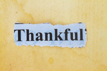 thankful: Thankful print in a newspaper cutout with vintage paper background