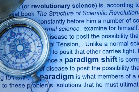 paradigm: Paradigm shift concept with compass and print