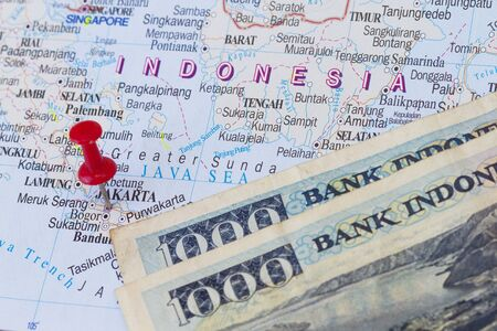 zoom earth: Jakarta on a map with Indonesian money