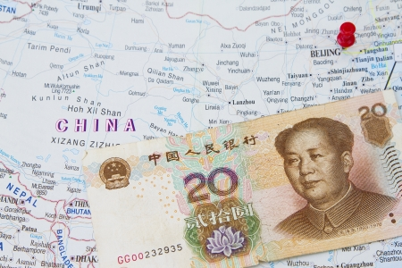 China and Yuan in a world atlas map  photo