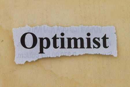 optimist: Optimist print in a newspaper cutout with vintage paper background