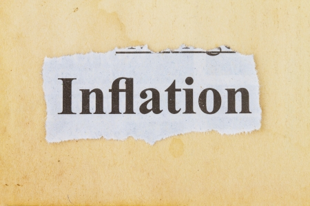 inflation newspaper cutout in an old paper background  photo