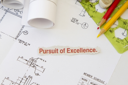 procurement: Pursuit of excellence abstract with engineering tools and hard hat