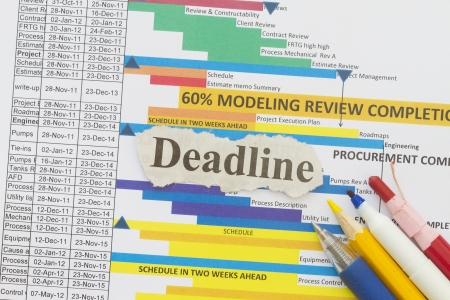 Deadline abstract - newspaper cutout with schedule chart background  Stock Photo